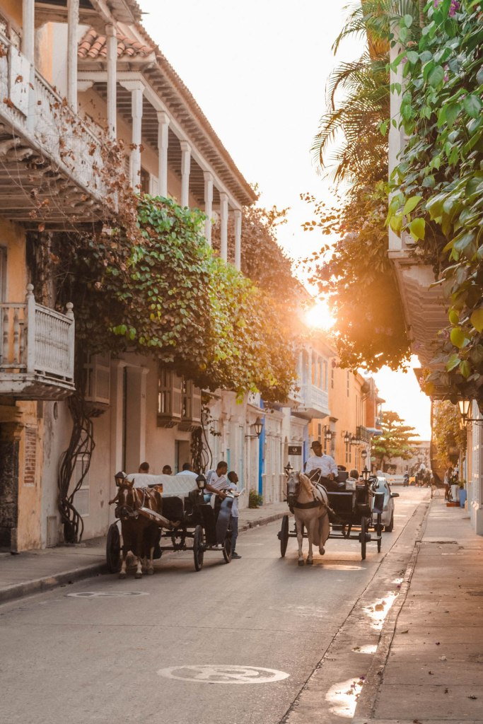 Horse drawn carriages trotting along the streets in Cartagena