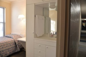 Each of the individual bedrooms includes a small wash area.