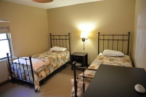 There are 4 bedrooms in the Thomas House with 2 beds each, for a total of 8 guests.