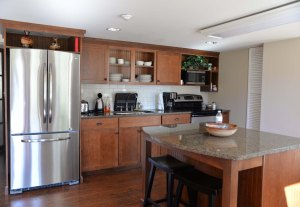 The kitchen area. Dishes and silverware, as well as cooking equipment and utensils are provided.