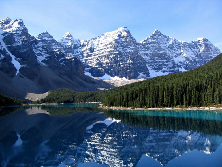 Moraine lake perfectly reflects the nearby seven peaks.