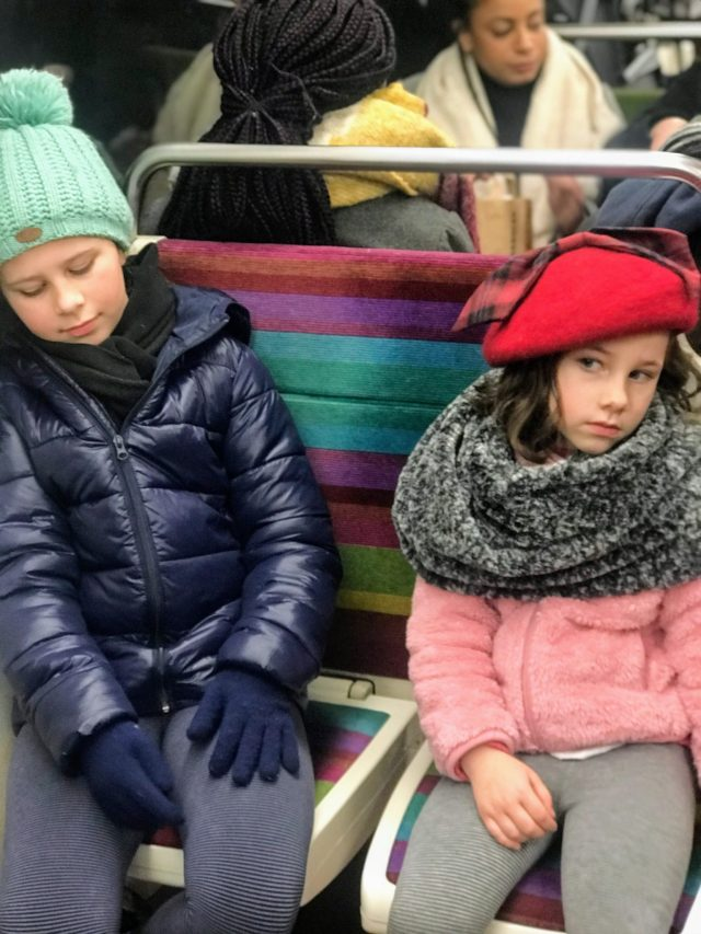 2 Kids that are bored on a train.