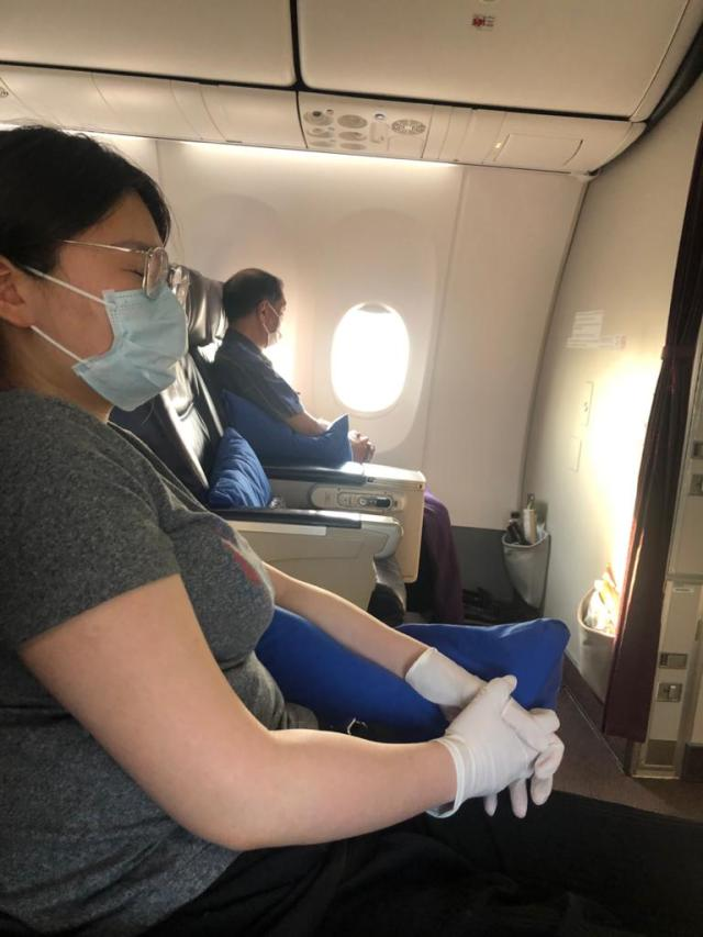 Passengers wearing masks on an airplane to travel safer after the coronavirus