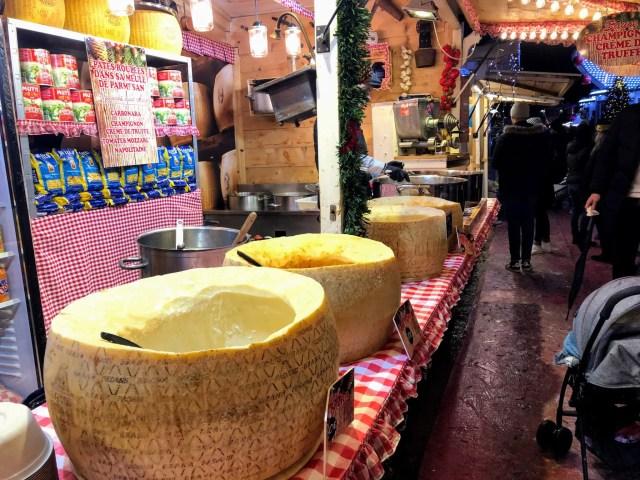 Bowls made of cheese at a French Christmas market. Virtual vacation to Paris.