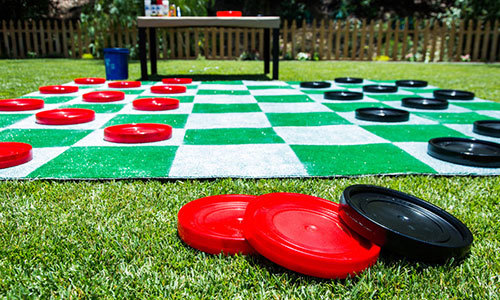 Life sized checkers in a backyard fun backyard staycation ideas.