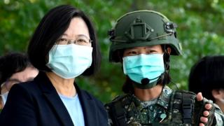 Taiwan's President with a solider, both are wearing a mask, Taiwan is one of the safest place to travel after Coronavirus