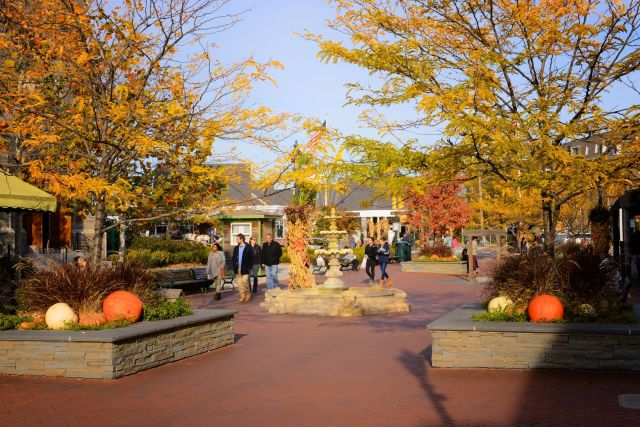 People walking through Cape May in the fall used to show one of the best places to visit in the fall.