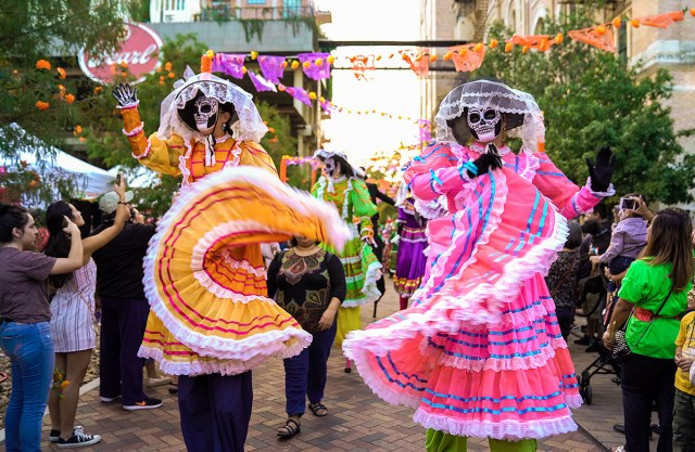 Two women dressed as skeletons for the Day of the Dead celebration in San Antonio. Showing that San Antonio is one of the best places to visit in the fall.