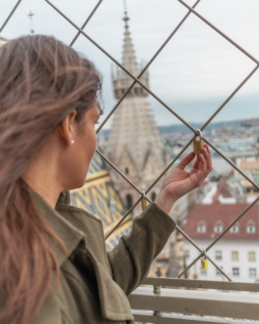 Me looking at a lock on top of St. Stephen's Cathedral one of the best places to take pictures in Vienna