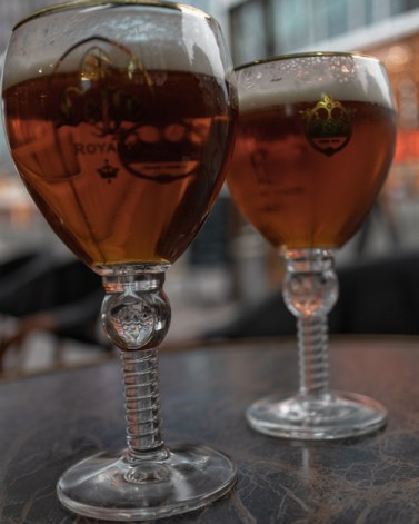 Two Belgian beers on a table at La Lunette.