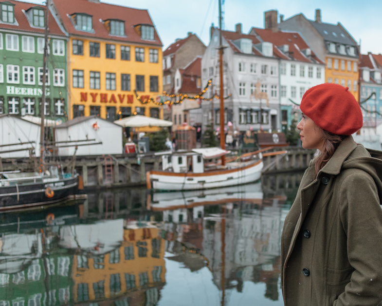 The me posing by the colorful houses on the Nyhavn river.