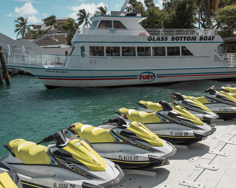Jet skis and a glass bottom boat.