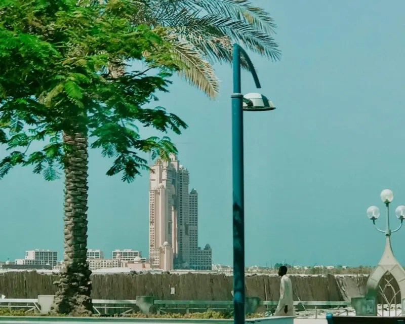 picture of Corniche Road with an Emirate walking