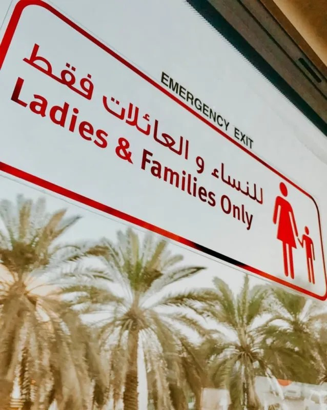"sign I saw that says ""Ladies and Families only"" on the bus from an abu dhabi day trip from Dubai"