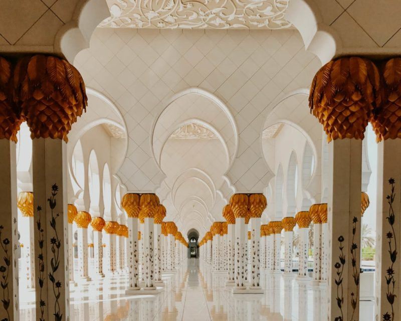 Long hallway in the Sheik Zayed Mosque seen during my Abu Dhabi day trip from Dubai
