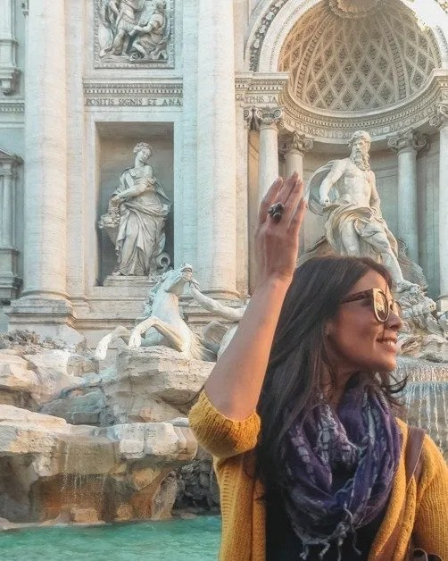 Me throwing a penny in the Trevi fountain in Rome an awesome solo female travel destinations
