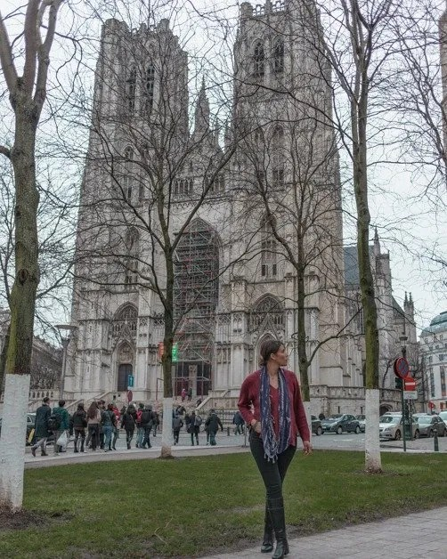 Me standing in front of The Cathedral of St. Michael and St. Gudula in Brussels an awesome solo female travel destination