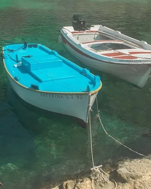 Picture of two boats on the water in Zakynthos one of the great solo female travel destinations