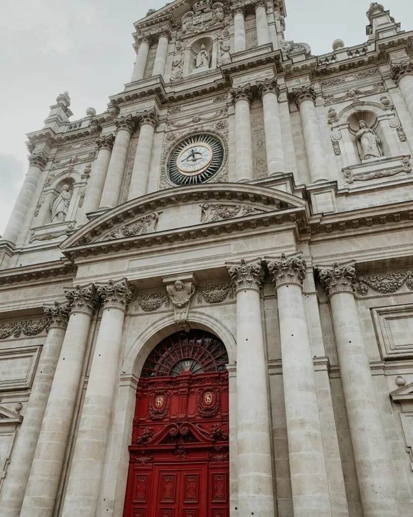 Red door entrance of Eglise Saint Paul Saint Louis Church.