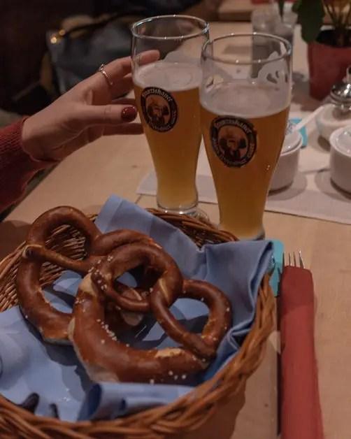 Reaching for pretzels at a Bavarian restaurant in Munich