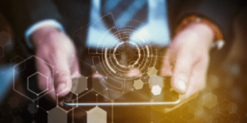 business man holding smartphone in hands with overlaying gold honeycomb graphic