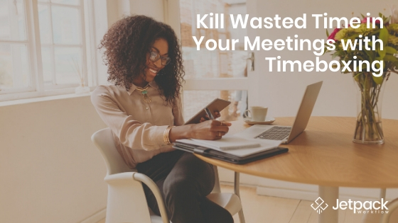 kill wasted time in your meeting with timeboxing- woman using laptop and taking notes happily working from home