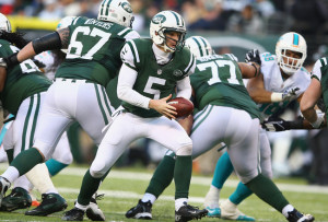 hi-res-452795629-matt-simms-of-the-new-york-jets-looks-to-hand-off-the_crop_650x440