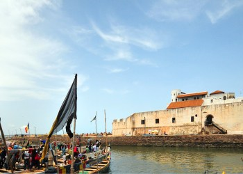 """Elmina, Ghana: Elmina Castle, an old Portuguese fortress - river side and fishing boats - S""""o Jorge da Mina castle, Feitoria da Mina, Portuguese Gold Coast - Unesco world heritage site - photo by M.Torres"""
