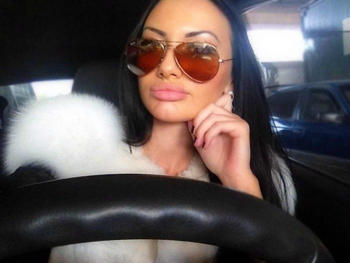 Glamour girl driving car
