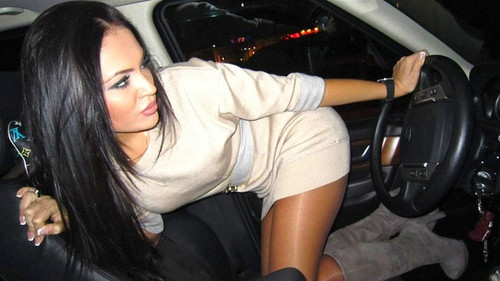 Glamour girl driving car