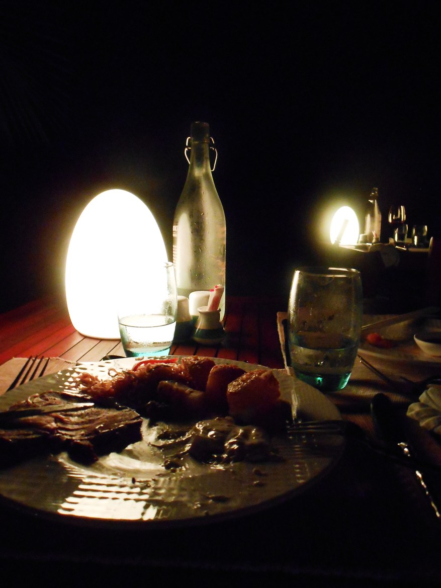 outdoor evening meal, steak dinner by the sea maldives