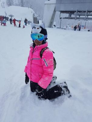 bright pink ski jacket and husky helmet cover