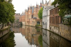 """Often called """"Venice of the North,"""" Bruges is a mindblowingly romantic city in Belgium. Walk through its windy streets and take a boat ride on the canal."""