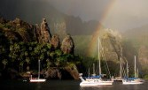 The Marquesas Islands are a group of volcanic islands in French Polynesia. Cruises go there with a full on romantic itinerary catered to honeymooners, but you can opt to self travel there as well and check out fairy-tale-like rainbows over the water.