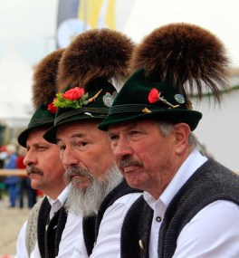 Traditionally, the more tufts of goat hair a Bavarian hat (Tirolerhüte) held, the wealthier that person was considered. Though nowadays hats full of synthetic hair can be purchased for cheap, it's safe to say that there's plenty of wealth to go around.