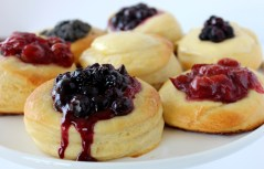 Kolache: Imagine it as a dessert pizza. It has a thin crust of delicious fluffy dough, but instead of tomato sauce and cheese, there is a fruit spread and sugar. To feel more like a local, try it with the very common poppy seed filling or figs. (Photo credit: howtofeedaloon.com)