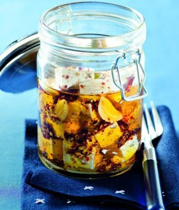 Nakládaný hermelín: Amazing pub food if you're a cheese lover! This is a soft cheese, from the same family as brie and camembert, marinated with peppers and onions in oil. (Photo credit: Pinterest)