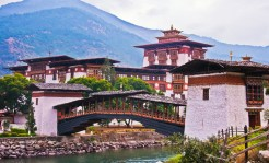 """Bhutan: Take part in the cultural traditions of the """"Kingdom in the Clouds"""" on visits to its historic fortresses, mountain villages and Buddhist temples, including the famous Tiger's Nest. Experience breathtaking views of the Himalaya, and join monks and nuns for prayer ceremonies. (Photo credit: National Geographic)"""