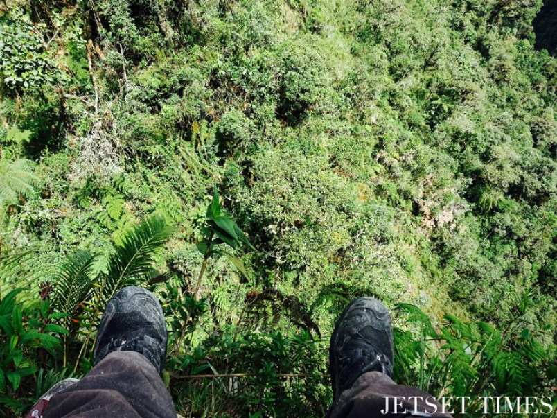 Dangling off the edge, admiring the view. Bolivia
