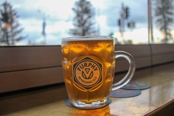 Pint of Furphy Refreshing Ale on first floor of Ravesis Hotel Bar in Bondi Beach, Sydney, Australia