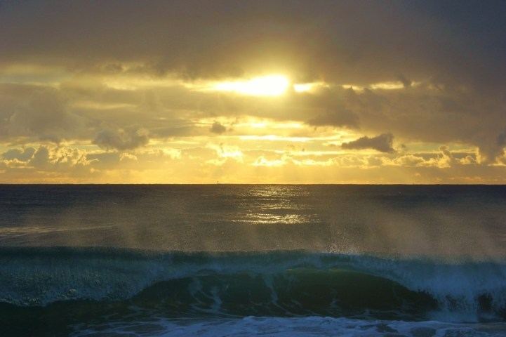 Misty waves at Snappers Rocks at sunrise in Coolangatta, Gold Coast, Australia