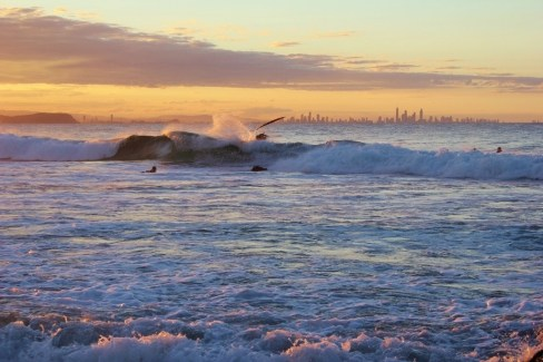 Surfer wipes out on wave at Snapper Rocks in Coolangatta, Gold Coast, Australia