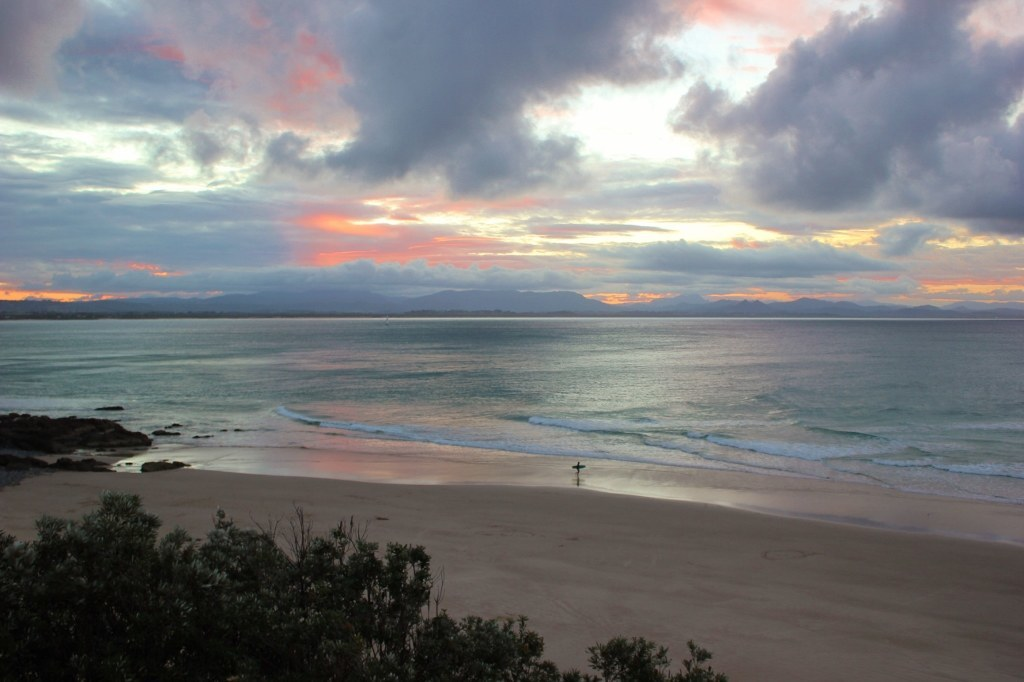 Watching sunset while hiking on the Byron Bay Lighthouse Walk in Cape Byron, Australia