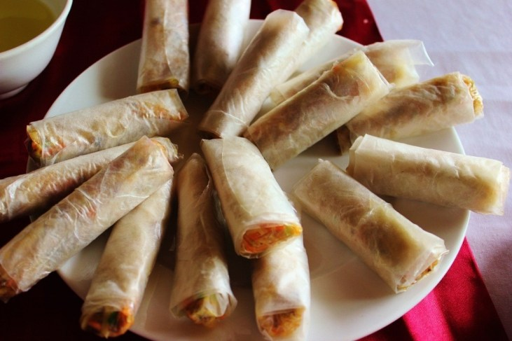 Fresh-made spring rolls prepared in cooking demonstration on junk boat during Halong Bay Cruise