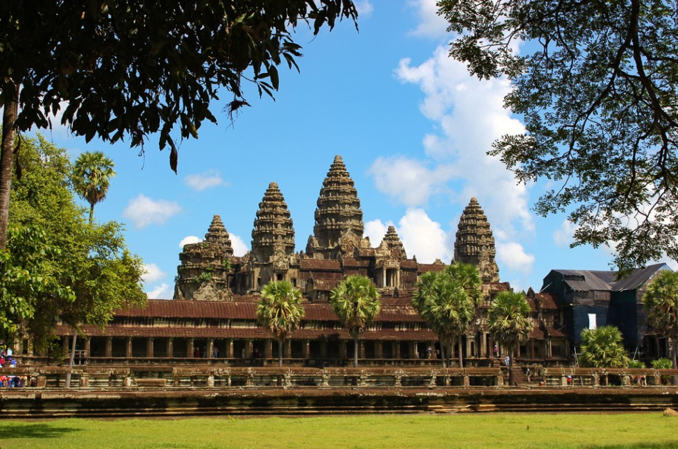 View of Angkor Wat Temple through trees at Angkor Park in Siem Reap, Cambodia