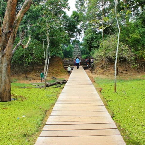 Wooden boardwalk to Neak Pean island temple at Angkor Park in Siem Reap, Cambodia