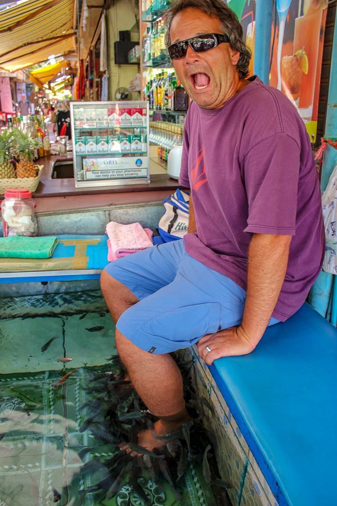 Getting a fish pedicure in Siem Reap, Cambodia