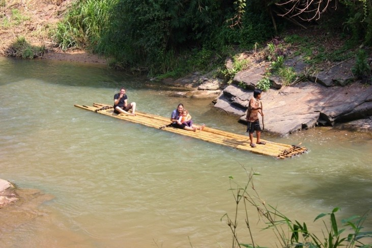 People on bamboo raft in Chiang Mai, Thailand
