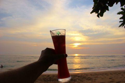 Drinking happy hour sunset cocktails on Klong Khong Beach in Koh Lanta, Thailand