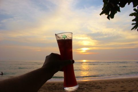 Drinking happy hour sunset cocktails on Klong Khong Beach in Koh Lanta, Thailand